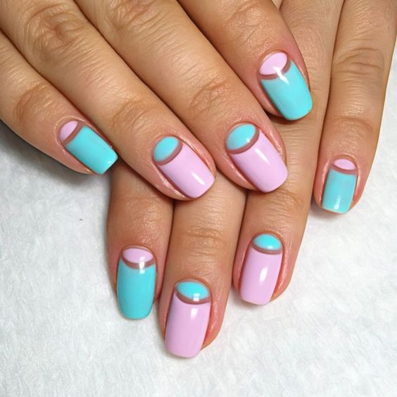 bold blue and pink half moon nails for summer