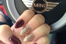 12 burgundy and gold glitter almond-shaped nails