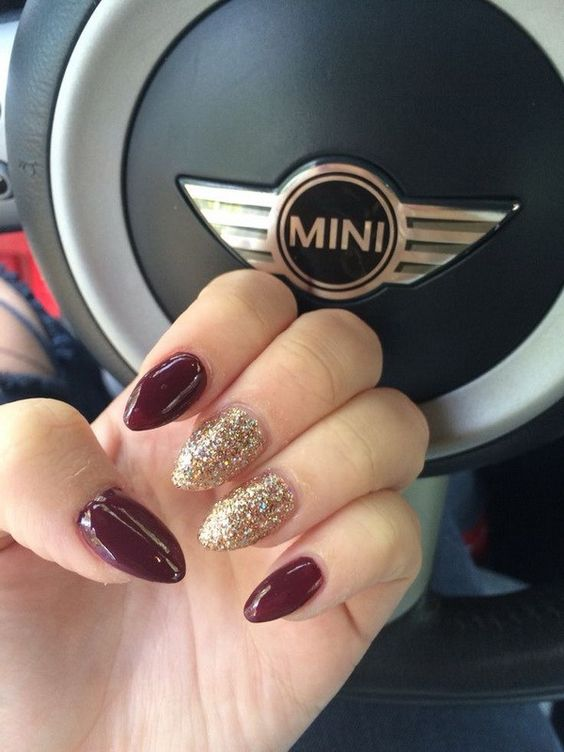 burgundy and gold glitter almond shaped nails