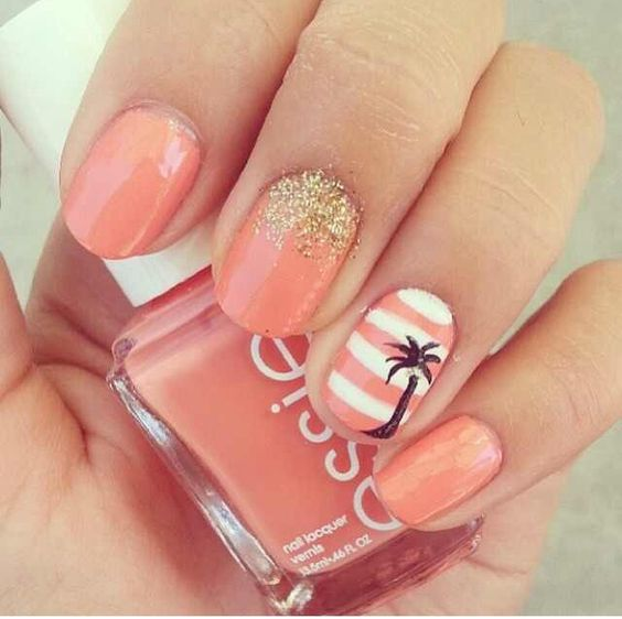 coral-colored nails with gold glitter and an accent striped nail with a palm tree