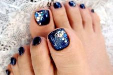 12 navy nails with sparkling beads of different shades