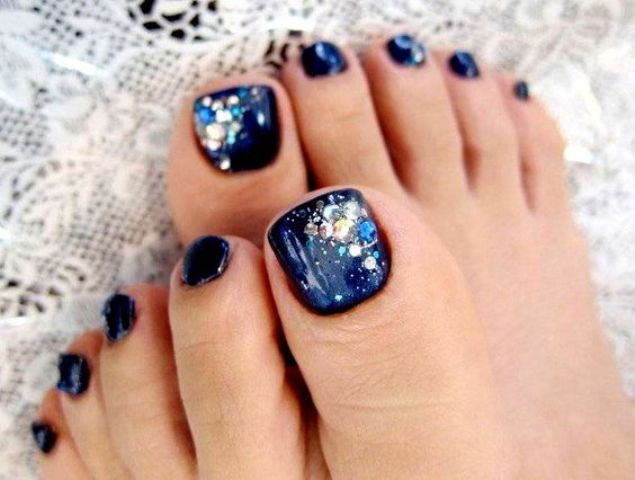 navy nails with sparkling beads of different shades