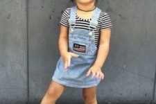 13 a striped black and white tee and a blue denim overall with boots