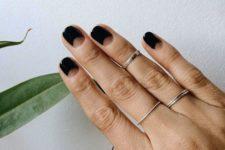13 black half moon nails for a minimal modern look