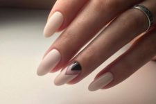 13 ivory nails and an accent chevron one with negative space and black
