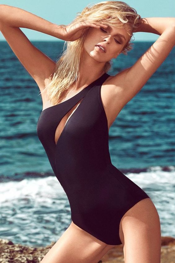 one shoulder black one piece bathing suit with a cutout