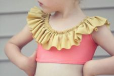 13 pink swimsuit with yellow ruffles here and there