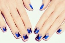 14 geometric nails with blue and navy triangles
