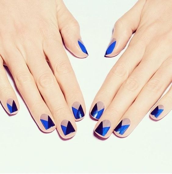 geometric nails with blue and navy triangles