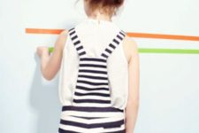 15 a white tee and a black and white striped overall