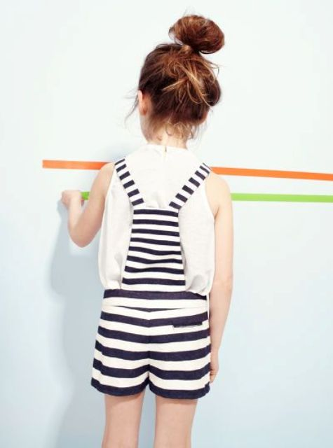 a white tee and a black and white striped overall