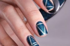 15 blue glitter nails with silver stripes