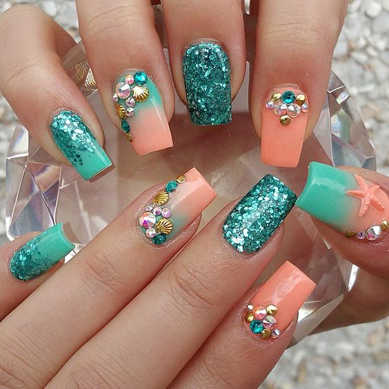 coral and turquoise nails with glitter, rhinestones and beads