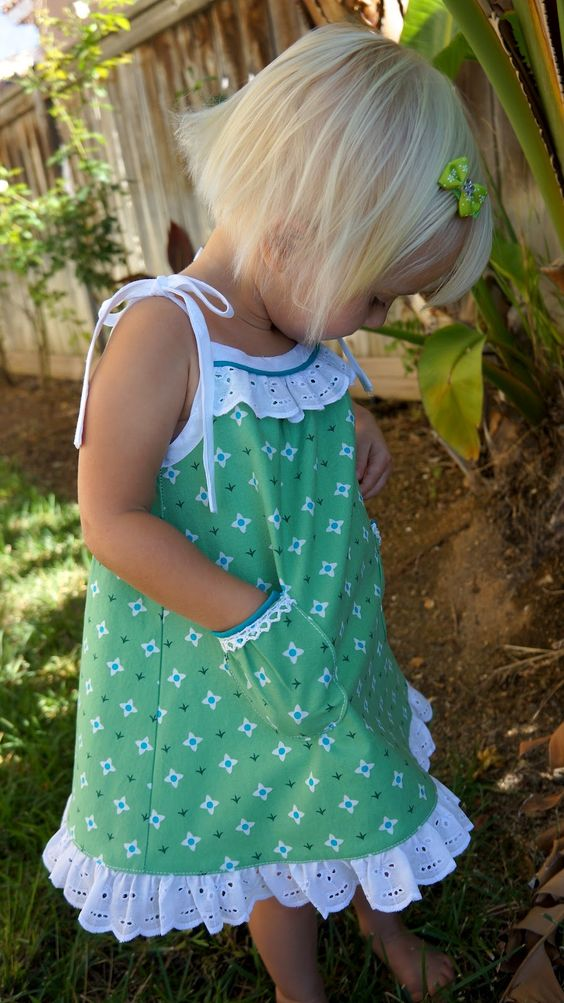 cute green printed dress with pockets and spaghetti straps