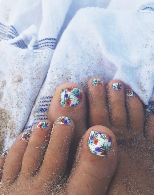 tropical flowers are an unusual idea for a toe nail art