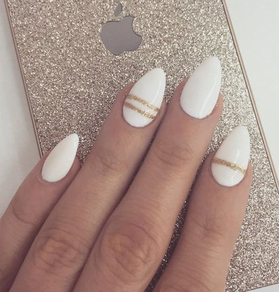 white nails with gold glitter thin stripes