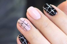 16 black and pink nails with chaotic stripes