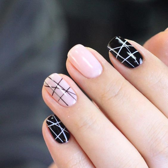 black and pink nails with chaotic stripes