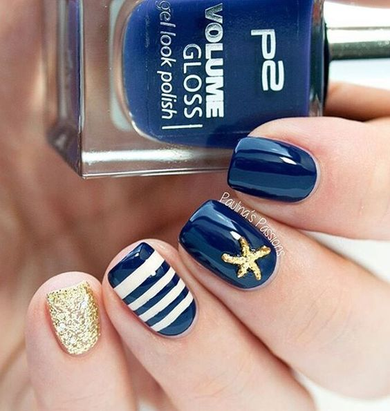 trendy short navy nails, a striped navy and white one, a gold glitter one and gold star fish decor