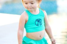 16 turquoise swimsuit with a top and a ruffled bottom with a skirt