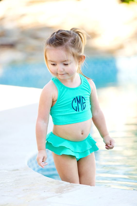 turquoise swimsuit with a top and a ruffled bottom with a skirt