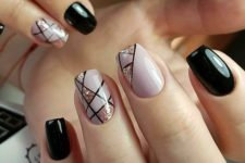 17 black and pink nails with stripes and glitter