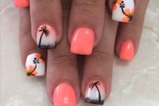 17 orange nails and accent ones with palm trees and tropical flowers
