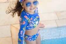 17 two piece blue floral swisuit with long sleeves and shorts