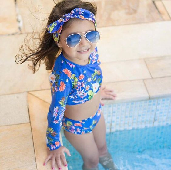 two piece blue floral swisuit with long sleeves and shorts