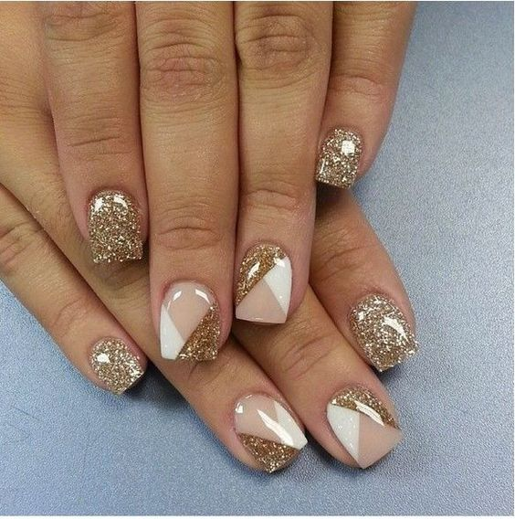 gold glitter nails and accent ones with blush and white triangles