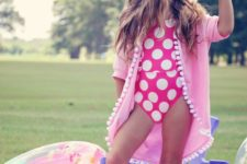 18 two piece pink swimsuit with large white polka dots