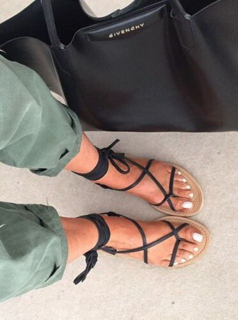 lace up flat sandals with a neutral base and black lace for a casual look