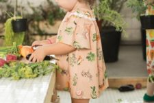 19 pink dress with whimsy prints and short sleeves