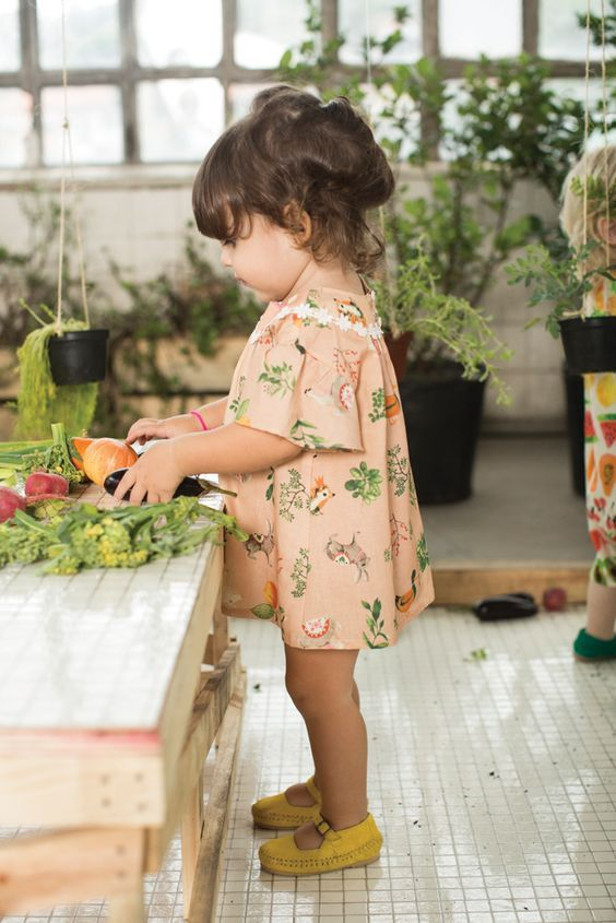 pink dress with whimsy prints and short sleeves