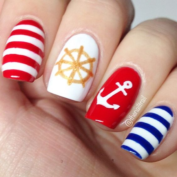 seaside nail art with striped, an anchor and a wheel