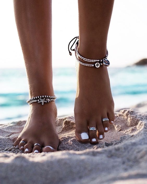 silver anklets with beads, starfish decor and pendants
