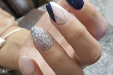 20 navy and blush nails with one silver glitter nail and one navy blush geo nail