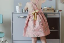 20 printed pink dress with a criss cross back and a yellow bow