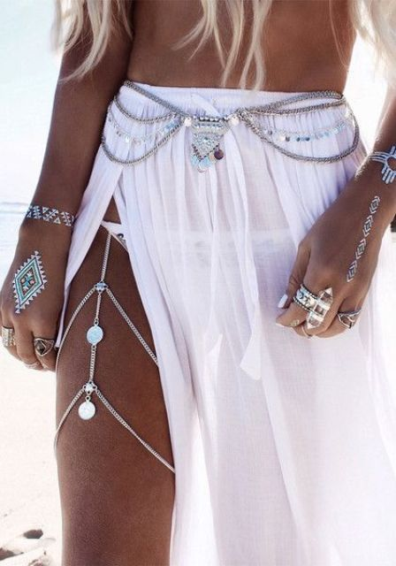 silver boho layered belly chain and a matching one on the leg