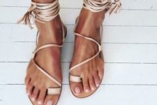 21 neutral gypsy-inspired lace up flat sandals with tassels