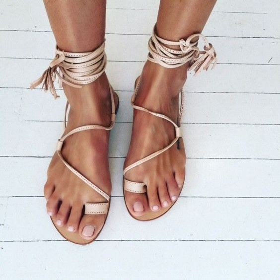 neutral gypsy inspired lace up flat sandals with tassels