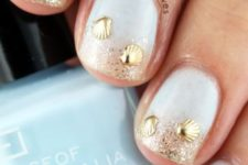21 white nails with gold glitter and gold shell decor