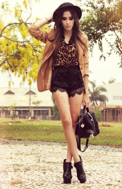 With animal print top, camel blazer, hat and platform shoes