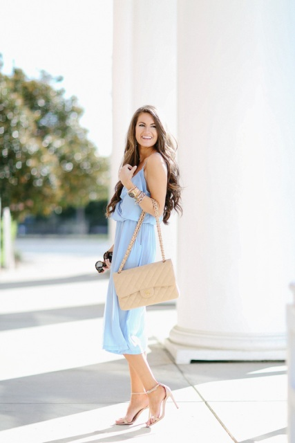 With beige bag and nude heels