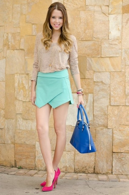With beige shirt, hot pink pumps and blue bag