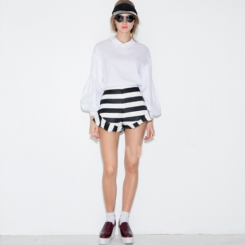 With bell sleeved blouse, white socks and platform shoes