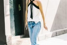 With black and white top and crop jeans