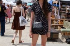 With black chain strap bag and white sneakers