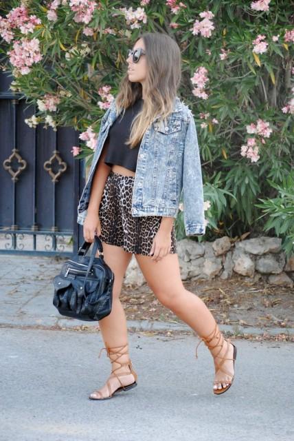 With black crop top, denim jacket, lace up sandals and black bag