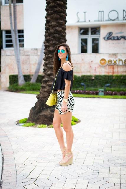 With black crop top, yellow bag and platform shoes